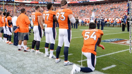 Brandon Marshall of the Denver Broncos takes a knee during the National Anthem before a game September 8.