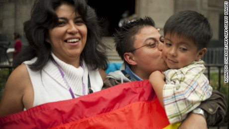Homosexual couple Ana Cruz (L) and Cynthia Juarez (R) with their four-year-old child Tonali, celebrate the approval of the homosexual adoption, in Mexico City, on August 16,2010. AFP PHOTO/Ronaldo Schemidt (Photo credit should read Ronaldo Schemidt/AFP/Getty Images)