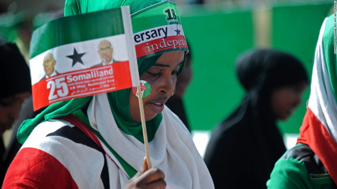 Woman waves flag during celebrations of the 25th anniversary of Somaliland's declaration of independence in the capital, Hargeisa on May 18, 2016.<br /><br />Despite the declaration, Somaliland is still considered an autonomous region of Somalia by the United Nations. But President Ahmed Mohamed Mohamoud Silanyo is pushing hard for recognition of full sovereignty.