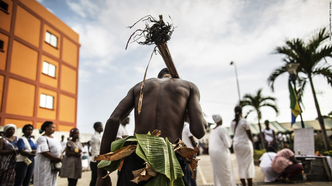 The unrest resulted in deadly violence, arrests and media black outs. Here,<br />a man traditionally dressed with banana leaves joins mourners paying their respects at an altar for those who died. <br />