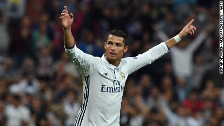 Real Madrid's Portuguese forward Cristiano Ronaldo (R) celebrates after scoring during the UEFA Champions League football match Real Madrid CF vs Sporting CP at the Santiago Bernabeu stadium in Madrid on September 14, 2016. / AFP / GERARD JULIEN        (Photo credit should read GERARD JULIEN/AFP/Getty Images)