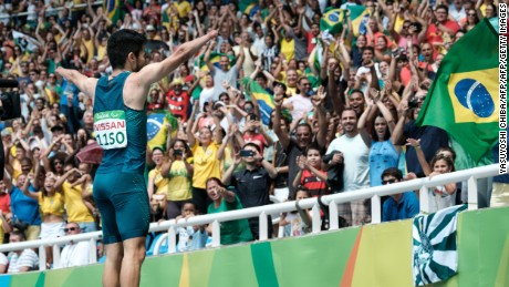 Brazil's Yohansson Nascimento takes the plaudits of the crowd after the 100m final.