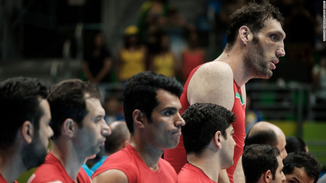 Iran's tallest man, sitting volleyball player Morteza Mehrzadselakjani stands with teammates before a preliminary match against Ukraine Wednesday.