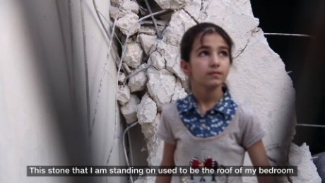 Doha, 10, was blown off the balcony of her family home in Aleppo by a barrel bomb blast.