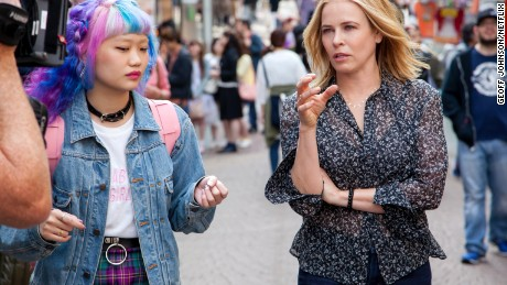 Chelsea Handler navigates the famous Takeshita Street in Harajuku with her guide, fashion blogger, Elleanor Yamaguchi. (Photo: Geoff Johnson/Netflix)
