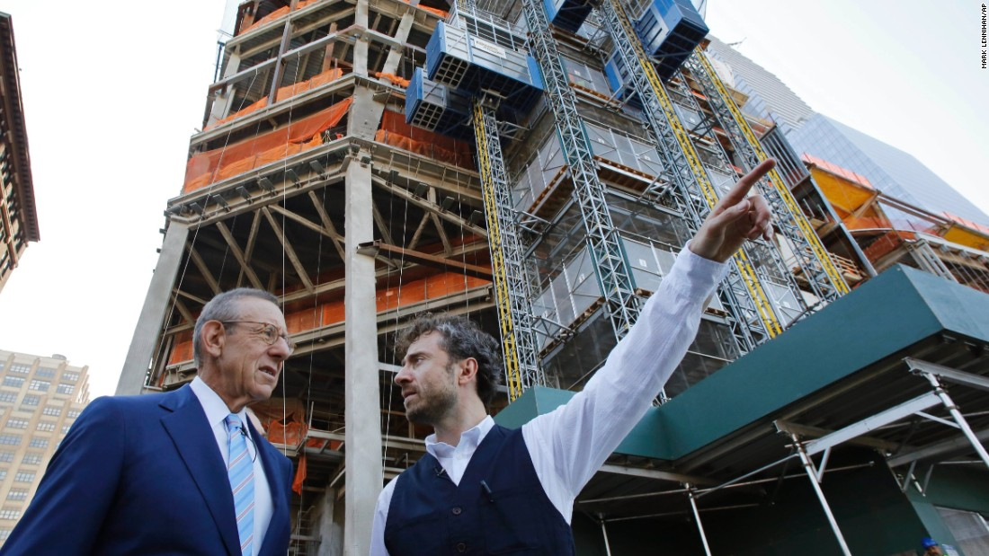 "Stephen Ross, (left) Chairman of Related Companies, talks with Thomas Heatherwick, the designer of the ""Vessel"" sculpture, at Hudson Yards, Wednesday, Sept. 14, 2016 in New York."