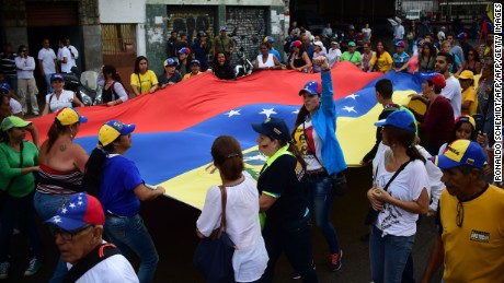 People demonstrate against President Nicolas Maduro, in Los Teques, Miranda State, Venezuela, on September 7, 2016 as the country's opposition called for new nationwide protests to pressure for a referendum on removing him from power by the end of the year.  Venezuela's opposition is holding nationwide protests against Maduro, testing his grip on power six days after massive demonstrations showed the magnitude of anger over a raging crisis. The leftist leader has called his own supporters to hold rallies across the country, seeking to show his strength in the face of opposition pressure. / AFP / RONALDO SCHEMIDT        (Photo credit should read RONALDO SCHEMIDT/AFP/Getty Images)