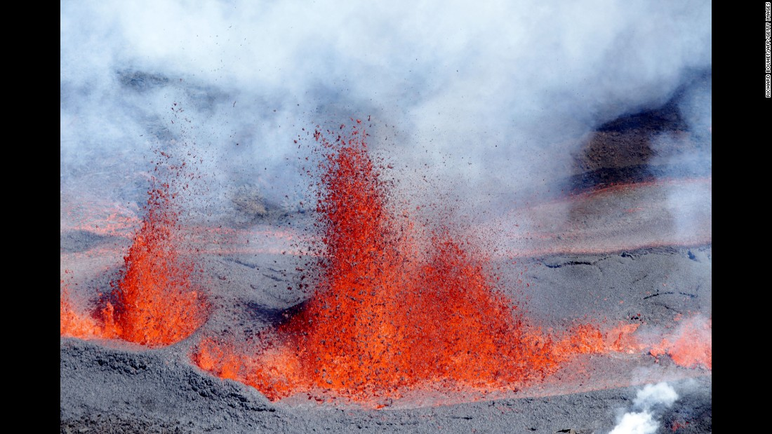 "Lava sprays from the ""Peak of the Furnace"" volcano on Reunion island, a French region, on Sunday, September 11."