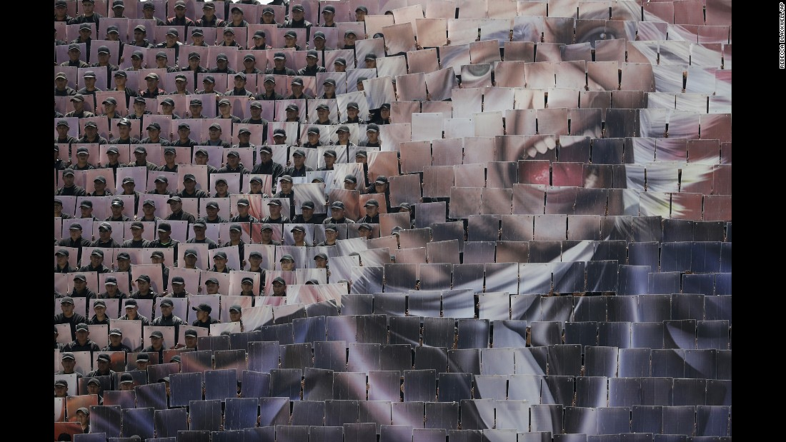 Mexican troops raise mosaic cards to reveal a face during a review of the troops for the country's Independence Day parade in Mexico City on Wednesday, September 14.