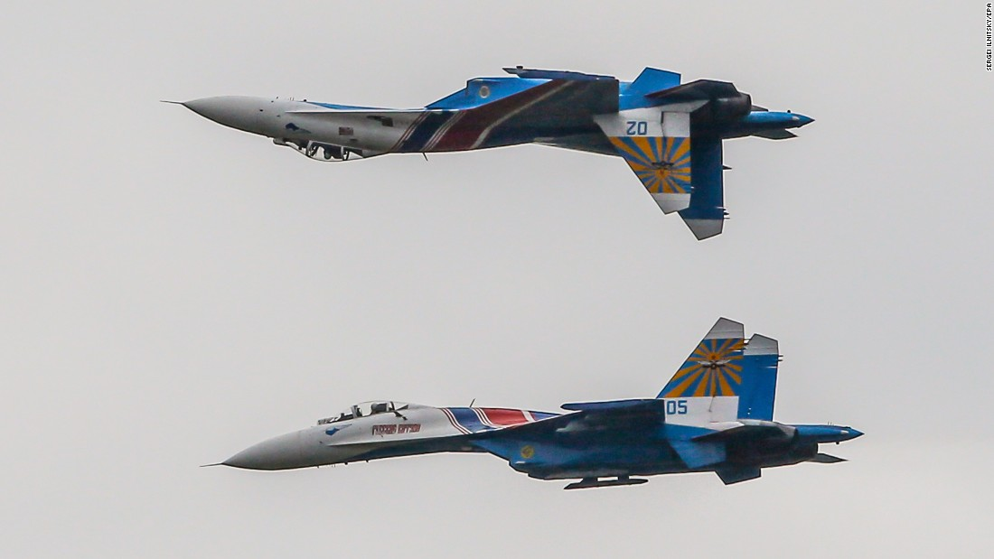"The Russian Knights -- a Russian Air Force  aerobatic demonstration team -- fly Sukhoi Su-27 fighter aircrafts during the ""International Military-Technical Forum"" -- an exhibition of weapons and military equipment -- in Kubinka, Russia, on Friday, September 9."