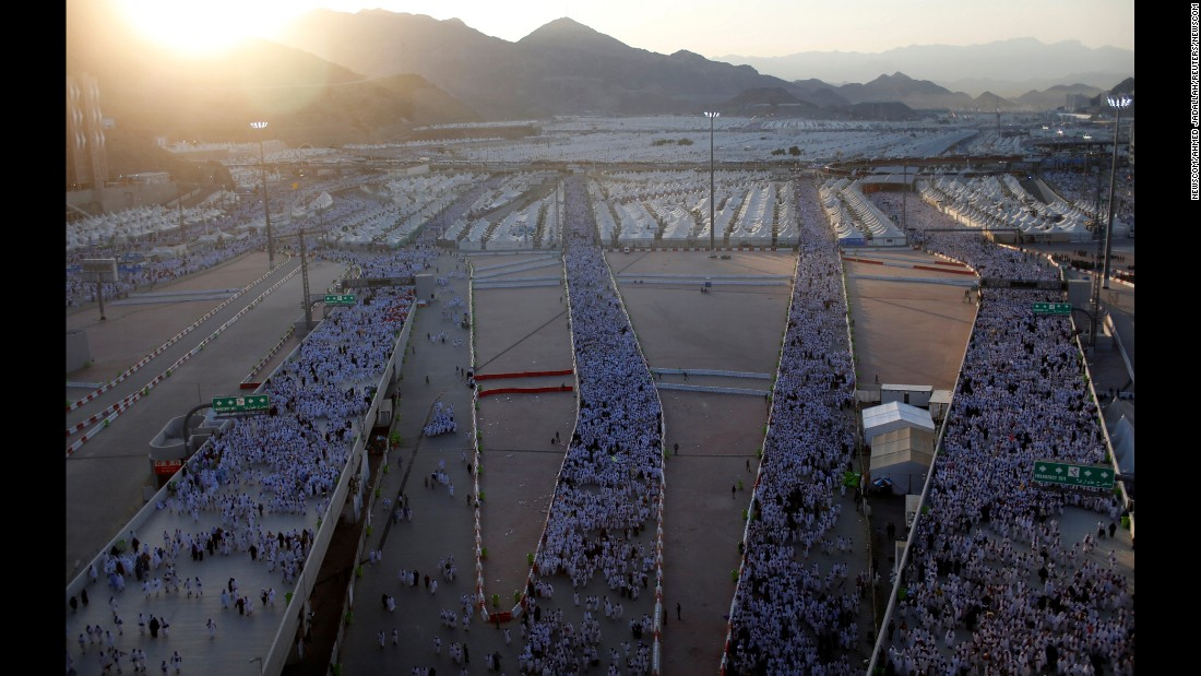 "Muslims make their way to the ""stoning of the devil"" during the holy <a href=""http://www.cnn.com/2016/09/09/middleeast/hajj-2016-saudi-arabia/"" target=""_blank"">Hajj pilgrimage</a> on the first day of Eid al-Adha near Mecca, Saudi Arabia, on Monday, September 12. The ""stoning of the devil"" is a key ritual where pilgrims throw stones at three pillars known as the ""Jamarat,"" symbolizing the rejection of the devil's temptation."