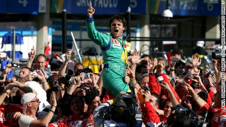 Massa is mobbed after becoming the first Brazilian to win a home GP since Senna in 1993.