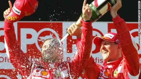 Massa is sprayed by the great Michael Schumacher as the Brazilian celebrates his first grand prix win.