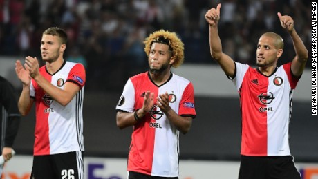 Bart Nieuwkoop, goalscorer Tonny Trindade and Karim El Ahmadi celebrate Feyenoord's win.
