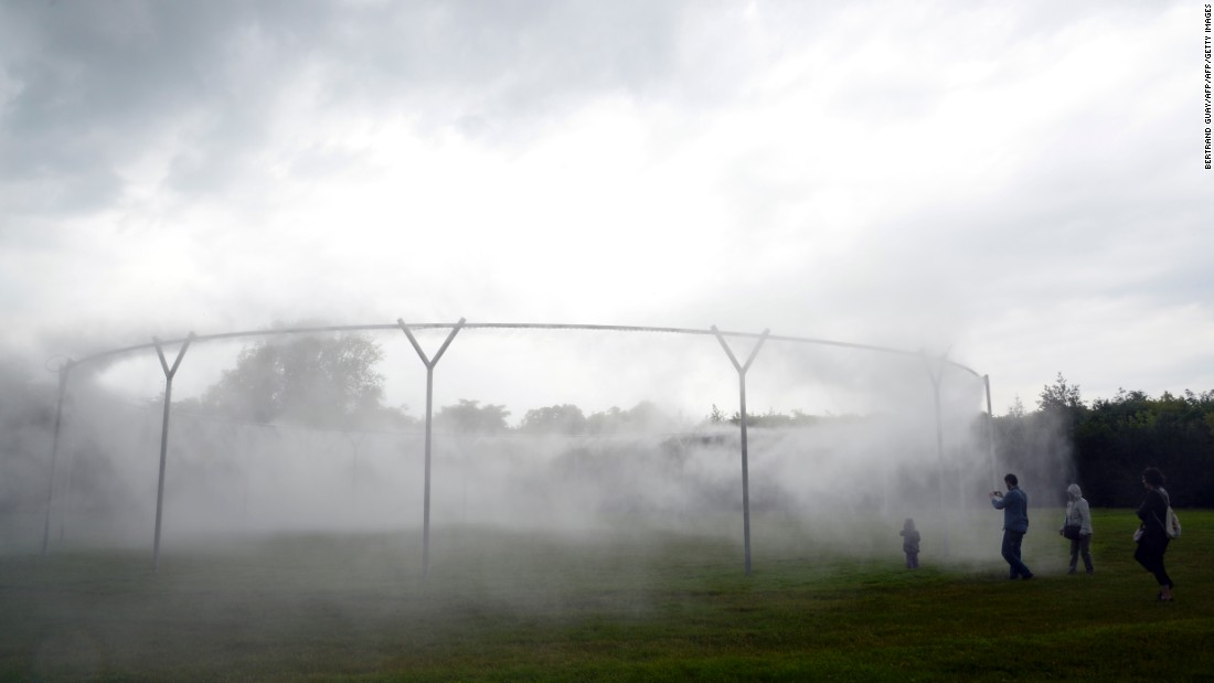 "The installation titled  ""Fog Assembly"" in the castle of Versailles, near Paris on June 11, 2016."