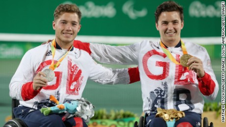 Gordon Reid and Alfie Hewett celebrate with their medals after the singles final.