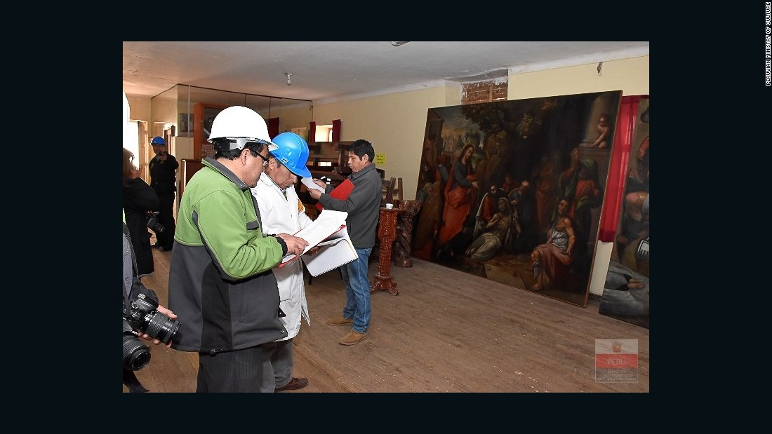Peruvian Ministry of Culture officials inspect damage to artwork at San Sebastian Church. The fire consumed priceless works from the so-called Cuzco School of Roman Catholic art.