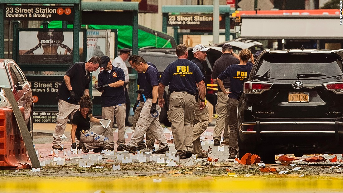 FBI agents review the scene of the explosion on Sunday morning.