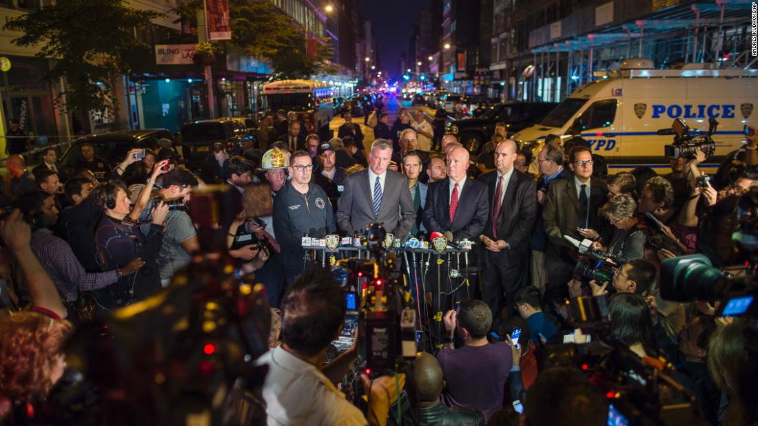 De Blasio, in the blue tie, speaks at a news conference near the scene on Saturday. He was joined by New York Police Commissioner James O'Neill.