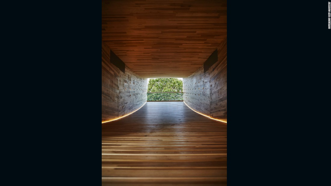 Cross-laminated timber (CLT) is an engineered timber that can be used to make the walls and floors of entire buildings. It has a layered construction with the wood fibers turned at right angles in each successive layer, creating a panel with equal strength in both directions.