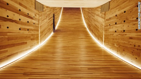 "The interior of ""The Smile"" by night. The structure showcases the structural and spatial potential of cross-laminated American tulipwood. Alison Brooks' concept is the first ever mega-tube made with construction-sized panels of hardwood CLT."