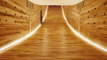 """The interior of """"The Smile"""" by night. The structure showcases the structural and spatial potential of cross-laminated American tulipwood. Alison Brooks' concept is the first ever mega-tube made with construction-sized panels of hardwood CLT."""