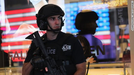 NEW YORK, NY - SEPTEMBER 19:  Heavily armed policemen stand guard in Times Square on September 19, 2016 in New York City. Police and military presence was heavy following weekend bombings in New York City and New Jersey. Meanwhile, some 200 world leaders are arriving to New York City for this week's United Nations General Assembly.  (Photo by John Moore/Getty Images)