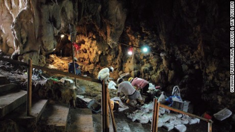 Researchers excavate Sakitari cave.