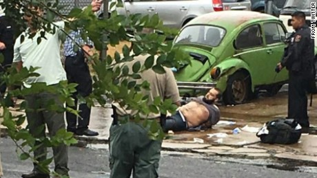 Ahmad Rahami seen on the ground during police capture.