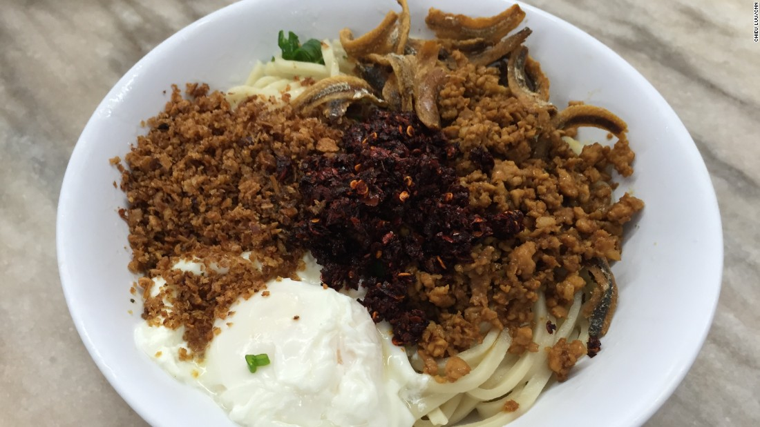 In Super Kitchen's chili pan mee, soft, chewy noodles are topped with fried anchovy, deep fried onions, fresh scallions, crushed peanuts, shredded pork and a poached egg.