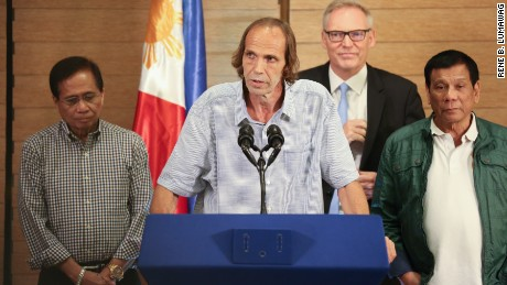 Freed Norwegian hostage Kjartan Sekkingstad speaks at a press conference with Philippines President Rodrigo Duterte.