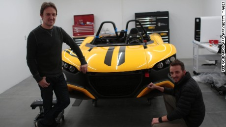 Guillermo and Iker Echeverría pose with a Vuhl 05 supercar.