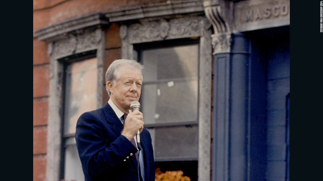 Jimmy Carter speaks outside the first Jimmy & Rosalynn Carter Work Project in New York City in 1984.