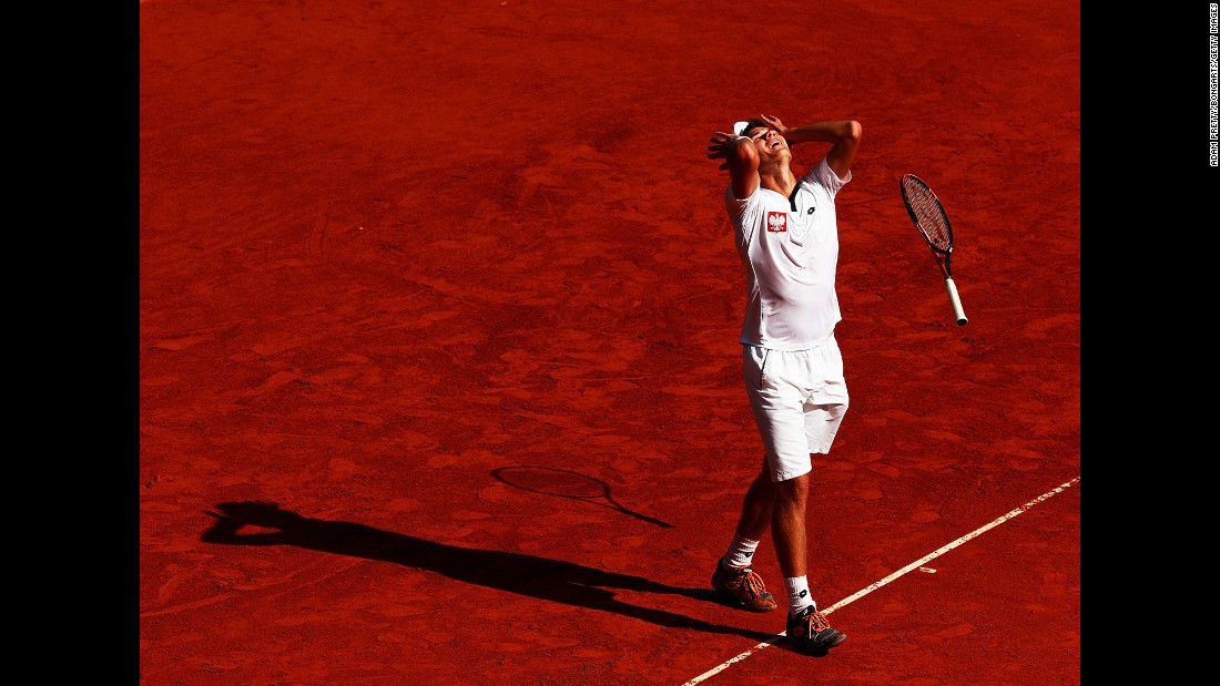 Poland's Kamil Majchrzak celebrates his Davis Cup win over Germany's Florian Meyer on Sunday, September 18. But Germany still won the playoff 3-2.
