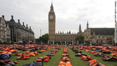 2,500 lifejackets, worn by refugees during crossings from Turkey to the Greek island of Chios, are displayed on Parliament Square, opposite the Houses of Parliament, in central London, on September 19, 2016, during a photcall to highlight the number of refugees that have died trying to reach Europe since 2015. A summit to address the biggest refugee crisis since World War II opens at the United Nations on Monday, overshadowed by the ongoing war in Syria and faltering US-Russian efforts to halt the fighting. World leaders will adopt a political declaration at the first-ever summit on refugees and migrants that human rights groups have already dismissed as falling short of the needed international response. / AFP / Daniel Leal-Olivas        (Photo credit should read DANIEL LEAL-OLIVAS/AFP/Getty Images)