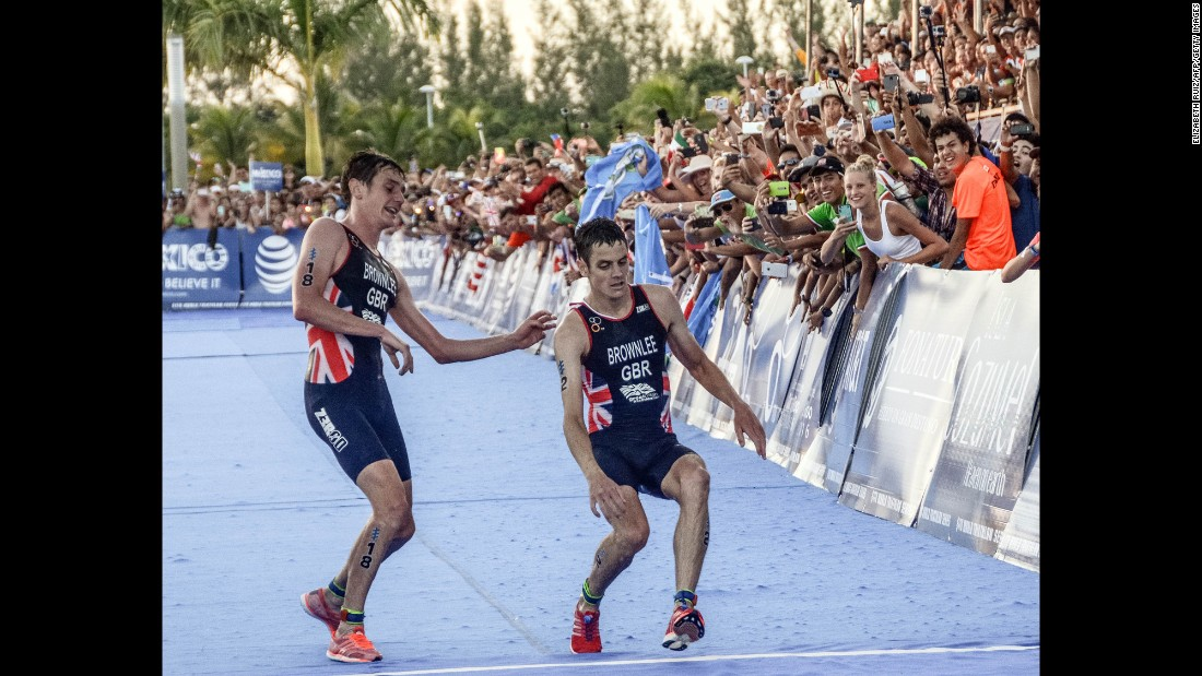 "British athlete Alistair Brownlee, left, <a href=""http://www.cnn.com/2016/09/19/sport/alistair-brownlee-jonny-brownlee-world-triathlon-series/"" target=""_blank"">helps his brother Jonny cross the finish line</a> at the World Triathlon Championships on Sunday, September 18. Jonny was leading the field coming into the final straight, but exhaustion rapidly set in during a hot day in Cozumel, Mexico. When he was at the point of collapse, his brother arrived on the scene. They finished together, with Jonny in second and Alistair in third. Jonny collapsed to the ground immediately and required medical attention. He later tweeted from a hospital bed that he was fine. Last month, the brothers finished 1-2 in the Olympic triathlon. Alistair won gold for the second straight Olympics."