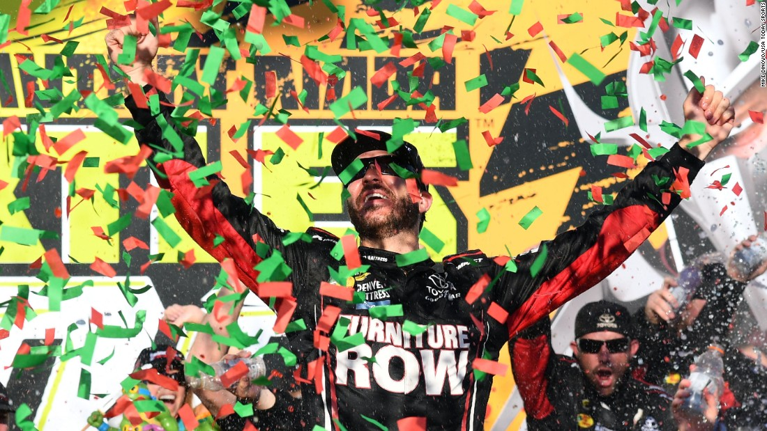 NASCAR driver Martin Truex Jr. celebrates after winning a Sprint Cup race at Chicagoland Speedway on Sunday, September 18. It was the first race of this season's Chase for the Cup.