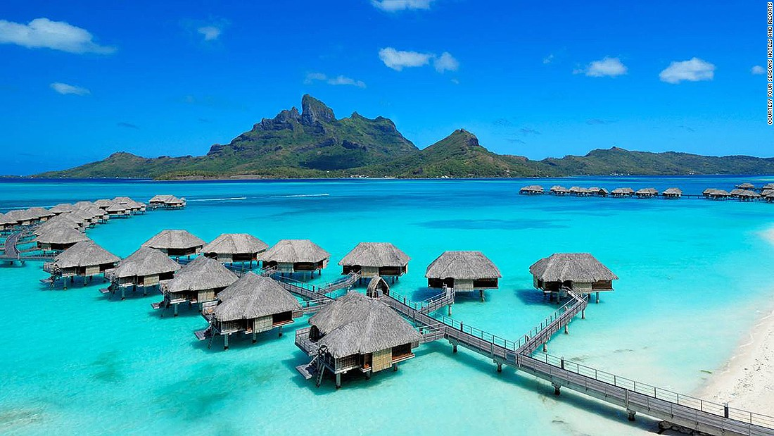 The Four Seasons Resort Bora Bora is arguably the most beautiful stay in the French Polynesia island. It's made up of 100 thatched-roof bungalows that stretch out over an emerald lagoon.