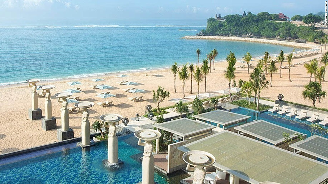 The Mulia is so large that it's home to two properties: The traditional Mulia Resort and the 180-villa Mulia Villas. It also features an infinity pool flanked by towering Balinese stone maidens just a stone's throw away from the beach.