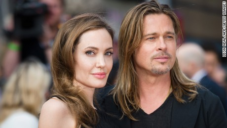 "Actress and humanitarian campaigner Angelina Jolie poses with her actor and fiance Brad Pitt as she arrives for the UK premiere of Brad Pitt's latest film ""World War Z"" in Leicester Square in central London in 2013. Jolie,"