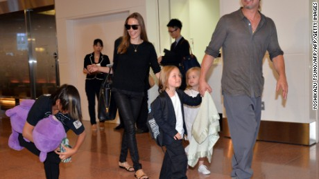 "US film stars Brad Pitt (R) and Angelina Jolie (2nd L), accompanied by their children, arrive at Haneda International Airport in Tokyo on July 28, 2013.  Pitt is now here for the promotion of his latest movie ""World War Z"".     AFP PHOTO / Yoshikazu TSUNO        (Photo credit should read YOSHIKAZU TSUNO/AFP/Getty Images)"
