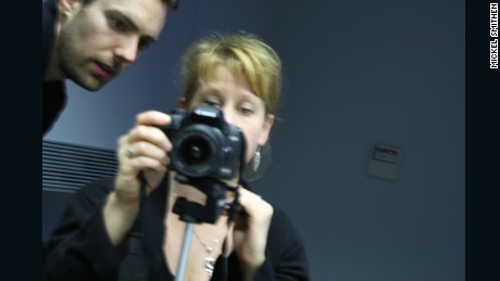 """Tanvir Bush with Matt Larsen-Daw of Photovoice"" (2009) by Mikel Smithen"