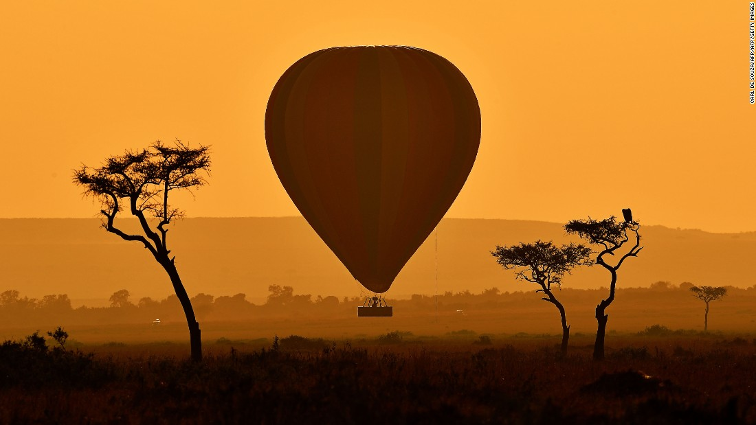 Three awesome experiences in one photo: A hot air balloon ride. The stunning sweep of Kenya's Masai Mara game reserve. And the annual wildebeest migration.