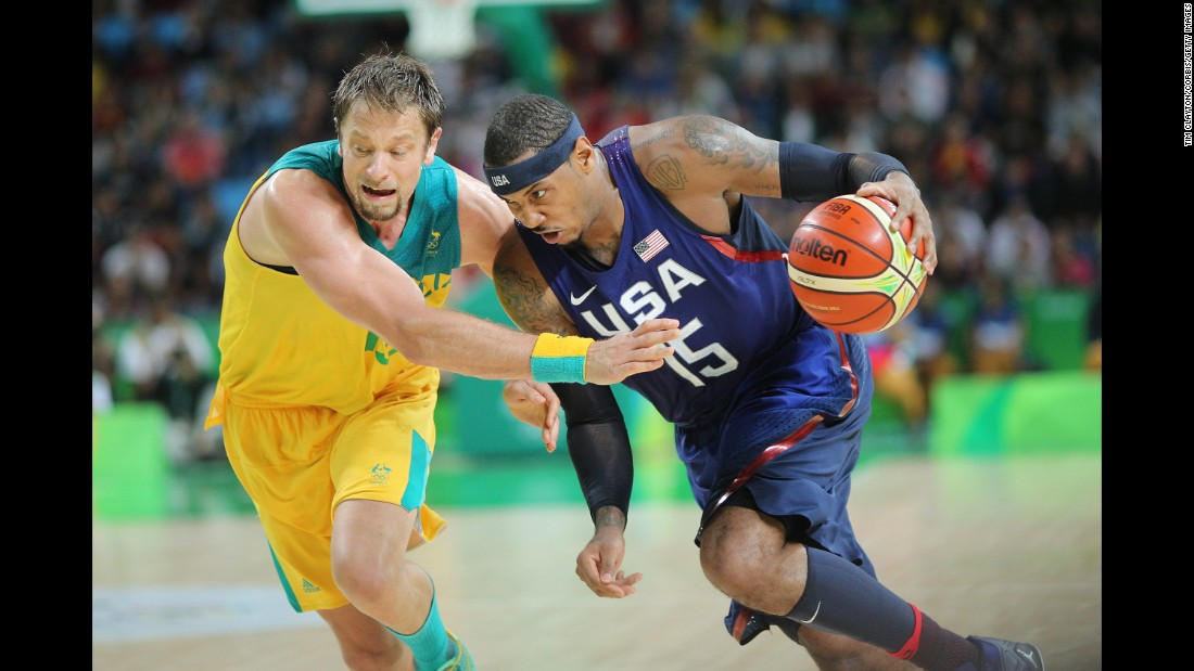 U.S. basketball player Carmelo Anthony drives to the basket against Australia.