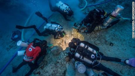 Archaeologists Brendan Foley, Theotokis Theodoulou and Alex Tourtas excavate the Antikythera Shipwreck skeletal remains, assisted by Nikolas Giannoulakis and Gemma Smith.