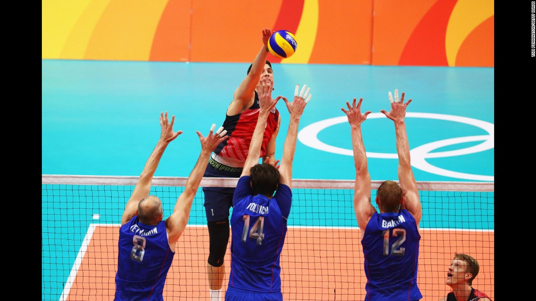 U.S. volleyball player Matthew Anderson spikes the ball against Russia during the Olympics.