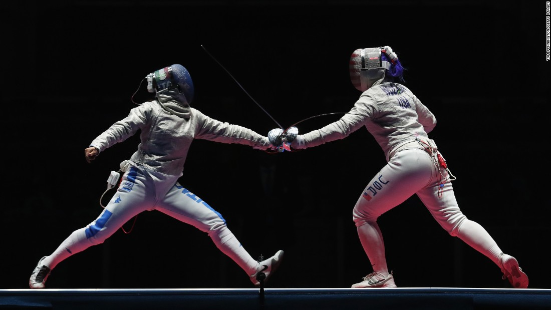 Italy's Rossella Gregorio, left, competes against American Dagmara Wozniak during a team sabre event.