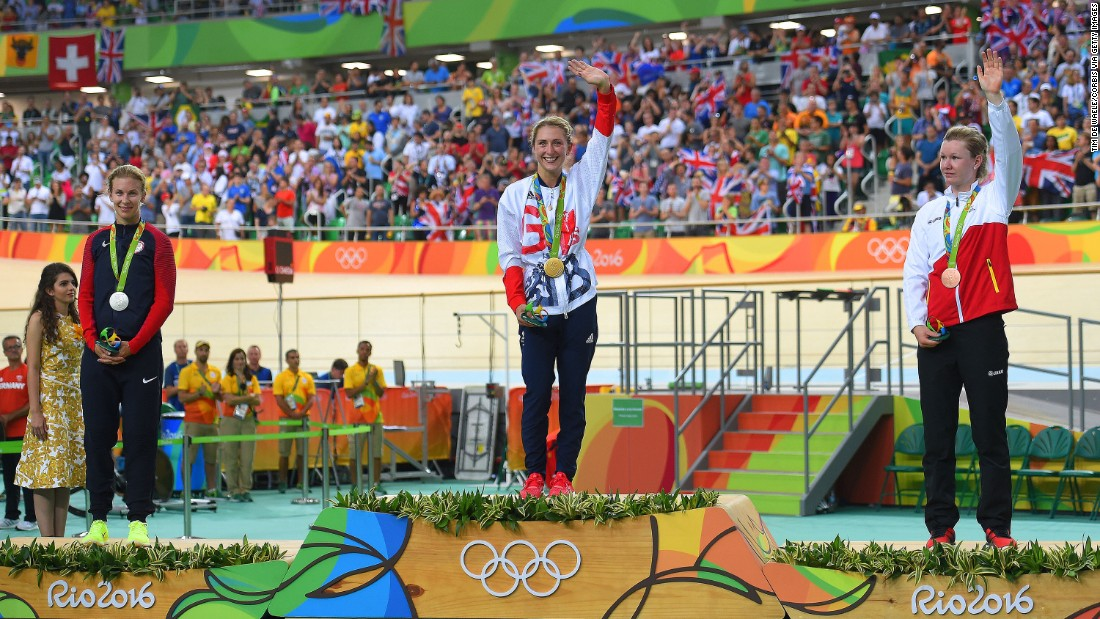 British cyclist Laura Trott, center, waves to the crowd after winning gold in the women's omnium.