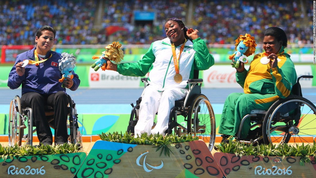Nigeria's Flora Ugwunwa, center, poses on the podium after winning gold in the javelin.