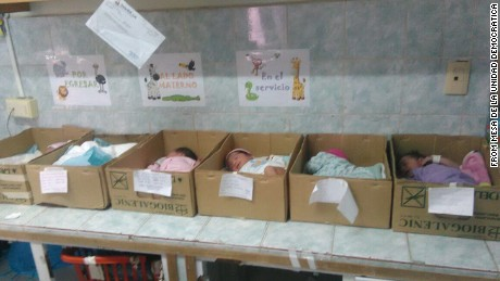Newborn babies sleep inside cardboard boxes in a Venezuelan hospital.
